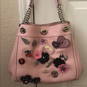 Pink leather Coach purse with Coach buttons